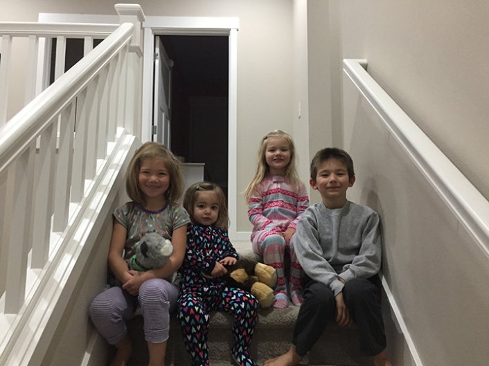Traditional Christmas morning top pf the stairs picture.